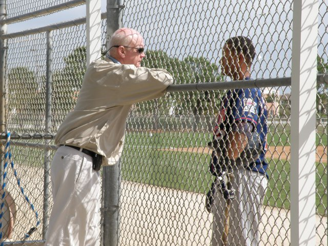 "Terry Ryan discusses the ""Twins way"" with a minor leaguer during spring training in 2010. The player quickly tucked his jersey back in his pants."