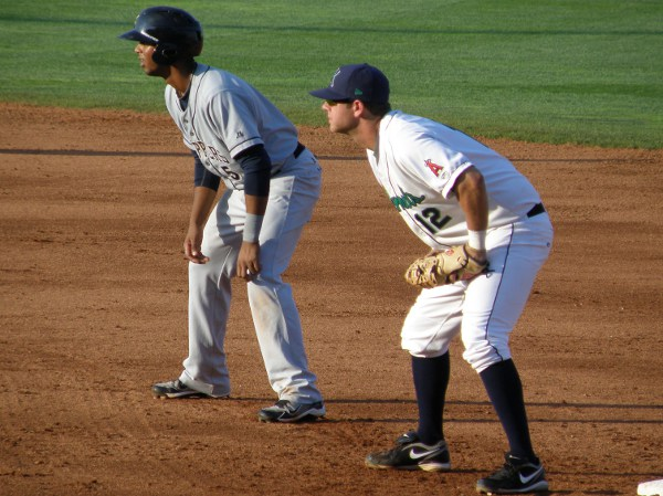 Snappers CF Aaron Hicks held on 1B by the Kernels' Casey Haerther