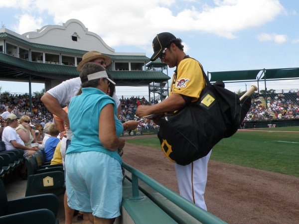 Former Twin Garrett Jones signed some autographs before the game