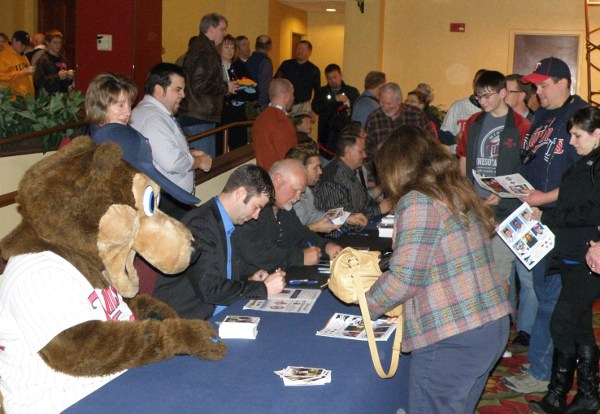 The autograph line: TC Bear, Jake Mauer, Ron Gardenhire, Brian Dozier, Terry Steinbach, N.J. Hermsen