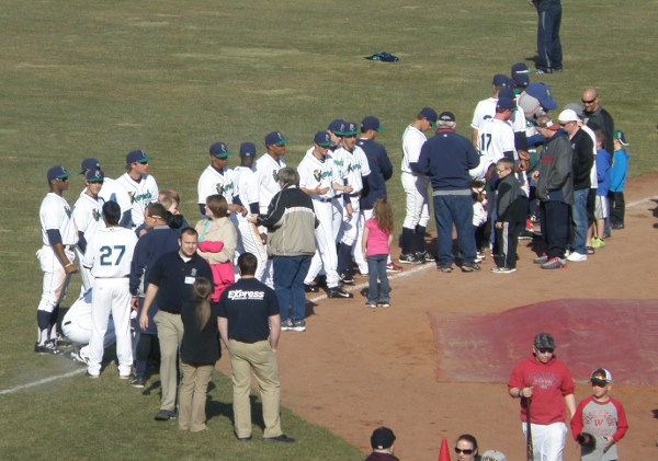 Kernels sign postgame autographs