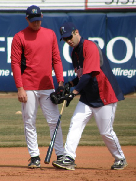 Manager Jake Mauer and 3B Travis Harrison working together pregame