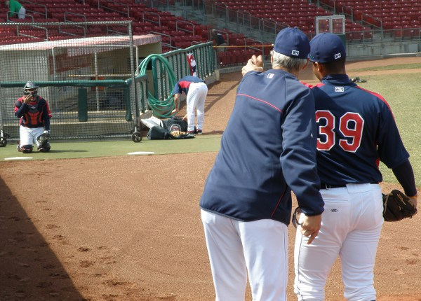 Pitching coach Gary Lucas works with Josue Montanez