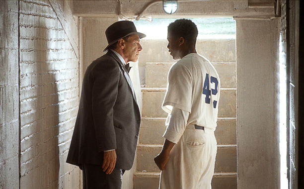 "(L-r) HARRISON FORD as Branch Rickey and CHADWICK BOSEMAN as Jackie Robinson in Warner Bros. Pictures' and Legendary Pictures' drama ""42,"" a Warner Bros. Pictures release."