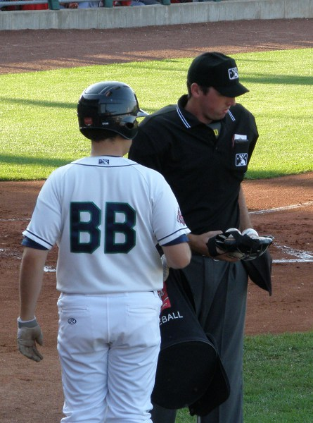 Plate umpire and Kernels ballboy switch out MLB balls for MWL balls between innings