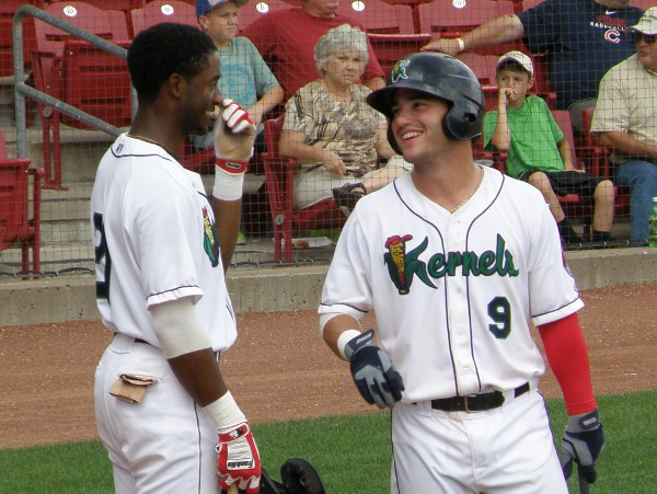 Tyler Grimes (9) shares a light moment in the on deck circle with Kernels team mate Niko Goodrum