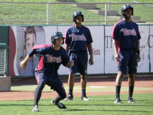 Jonathan Murphy goes through pregame baserunning drills as Jorge Polanco and Niko Goodrum wait their turns