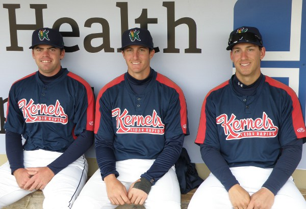 Kernels catching corps, from left to right: Bo Altobelli, Michael Quesada and Mitch Garver