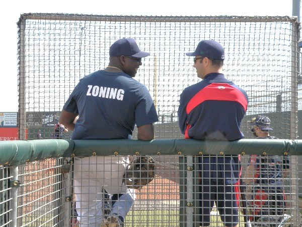Kernels pitching coach Ivan Arteaga and manager Jake Mauer share a light moment while watching a pair of Kernels pitchers work out. (Photo: JC/Knuckleballsblog.com)