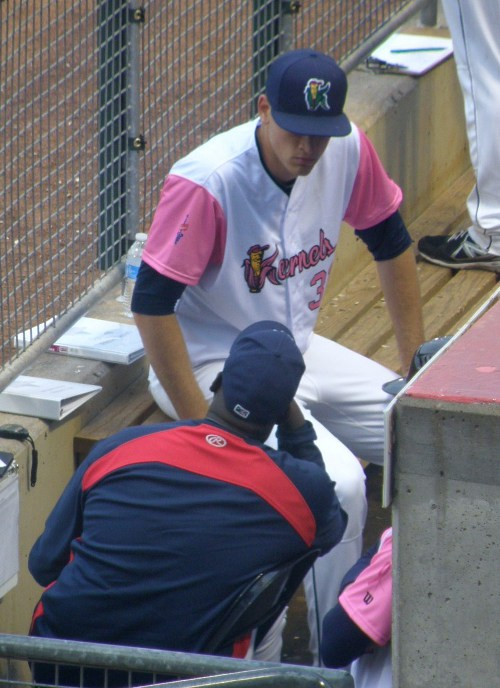 Aaron Slegers having a between-innings conversation with pitching coach Ivan Arteaga