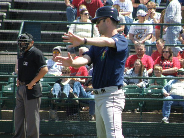 Manager Jake Mauer coaching 3B in the first inning. That's something he would not be doing by the 9th inning, however.