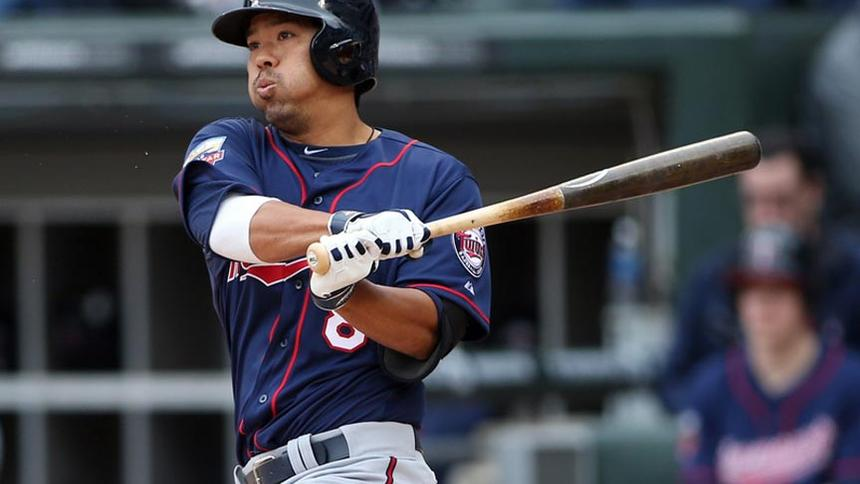 Minnesota Twins catcher Kurt  Suzuki (8) hits a two-run single against the Chicago White Sox in the third inning of an opening day baseball game at U.S Cellular Field in Chicago on March 31, 2014. (Jerry Lai-USA TODAY Sports)