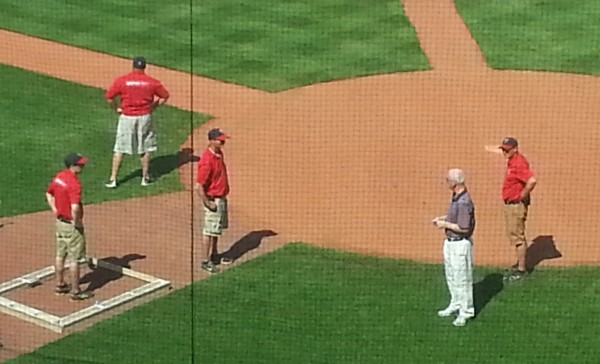 Twins GM Terry Ryan chats with members of the Cedar Rapids grounds crew