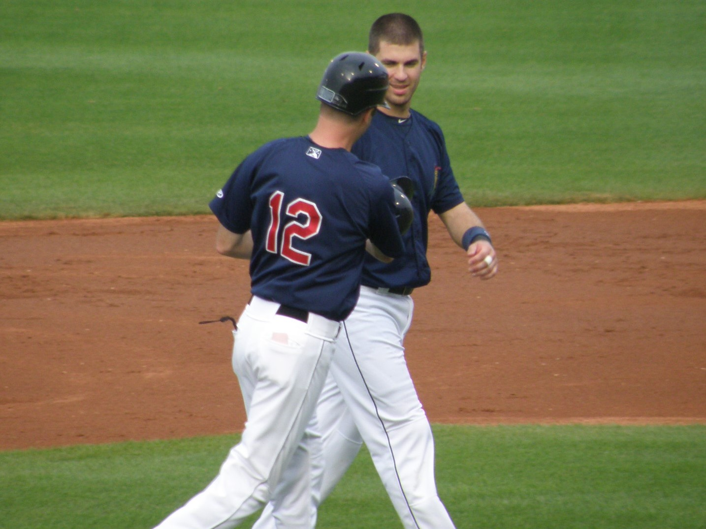 Jake Mauer picking up after his younger brother after Joe is left stranded at 2B
