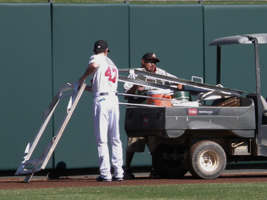 Jake Reed gives a helping hand to a grounds crew member who took a corner a bit sharp