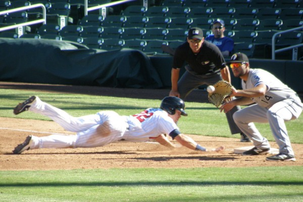 Max Kepler diving back in to first base on an attempted pick off