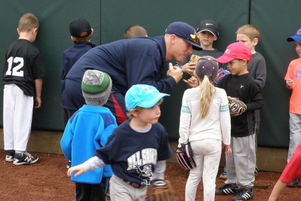 "Cam Booser gets a ""pinky promise"" from a young camper"