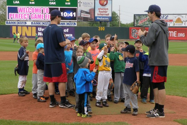 Brett Doe and John Curtiss getting organized with some campers on the mound