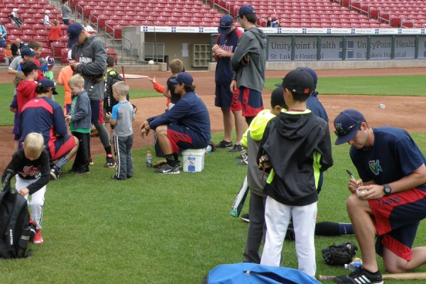 Kernels players signing autographs after the camp wrapped up