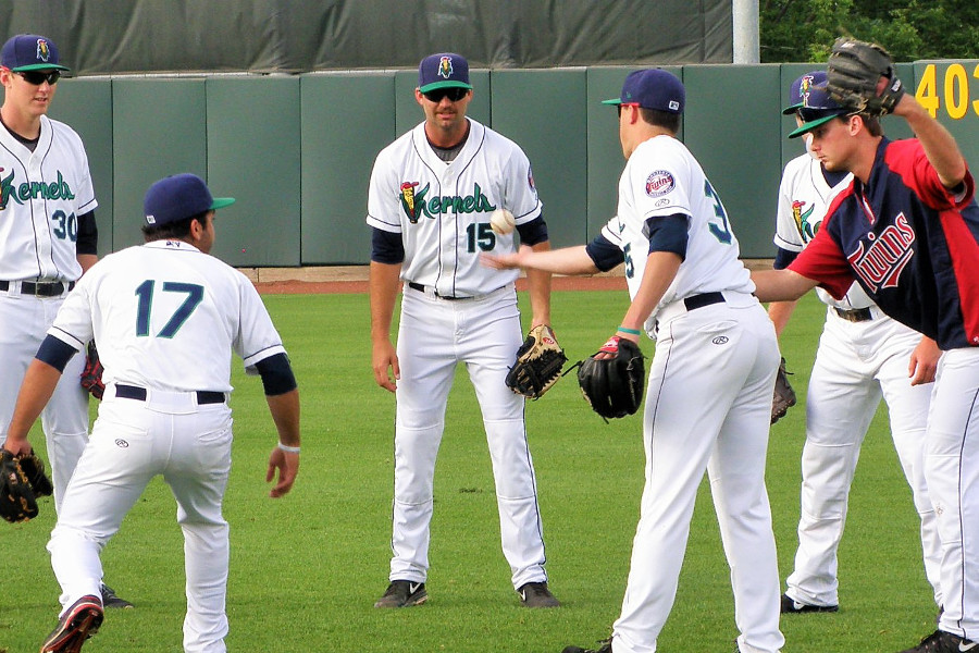 Randy LeBlanc (15) in a pregame ritual game of flip with other Kernels pitchers (Photo: SD Buhr)