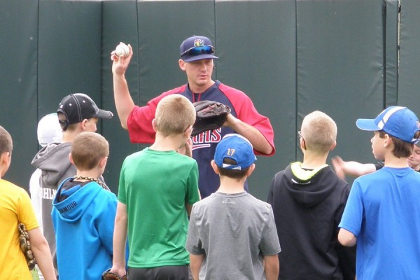 Zach Tillery with instructions for campers on proper grip and form
