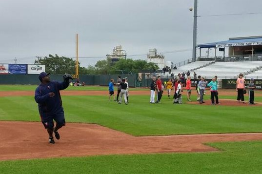 Kernels hitting coach Tommy Watkins was directing things at the camp but pitched in with the workout stations, too