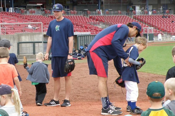 Jared Wilson and Michael Theofanopoulos working in the bullpen with young pitchers