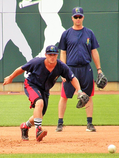 Pat Kelly gets pregame work in at third base under the watchful eye of Kernels manager Jake Mauer (Photo: SD Buhr)