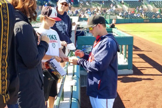 Mitch Garver doing the autograph thing before Thursday;s game.