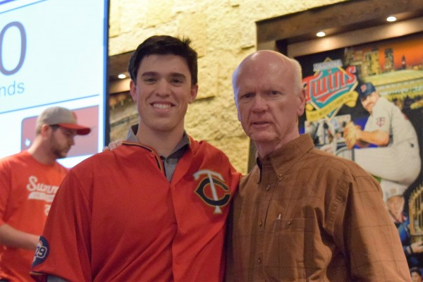 Trevor Hildenberger and Terry Ryan pose after participating in some fan games in the Champions Club