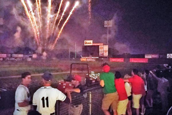 No, it's not the greatest picture in the world, but the postgame fireworks were outstanding. Here, AJ Murray and Sam Clay take them in along with Kernels staff members gathered in the home dugout.