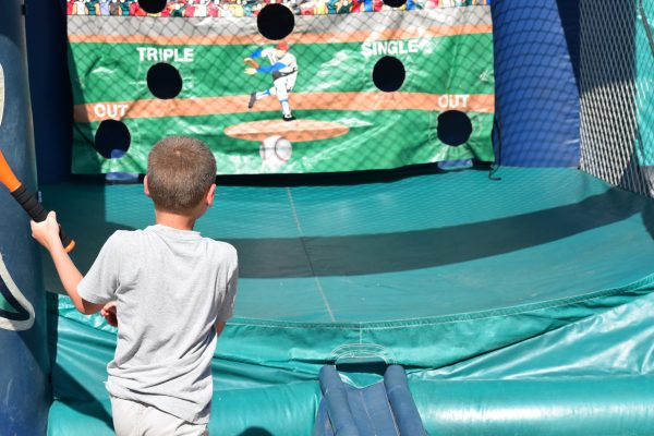 A young fan takes his cuts at one of the games during Fanfest