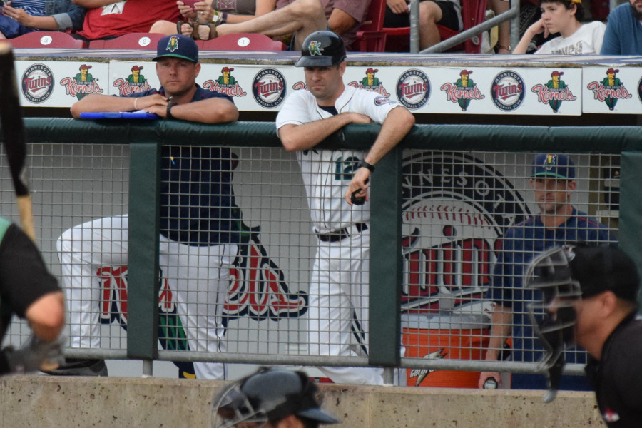 (L-R) Cedar Rapids Kernels pitching coach JP Martinez, manager Jake Mauer and hitting coach Brian Dinkelman (behind screen) )Photo: SD Buhr)
